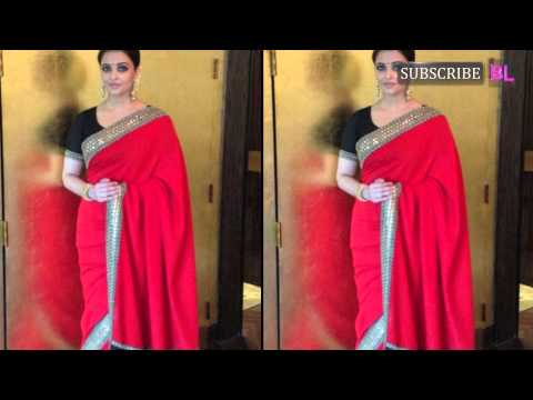 Lady in red: Aishwarya Rai Bachchan sizzles in a saree!