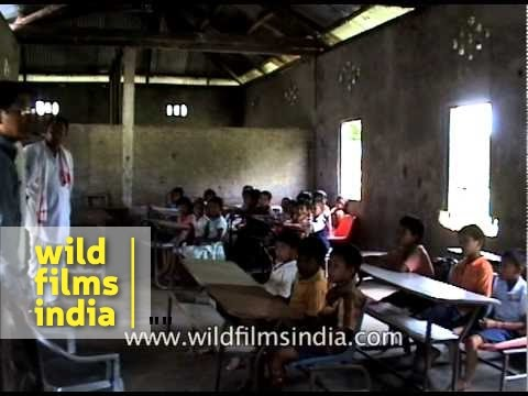 Teacher interacts with students during World Environment Day, Assam
