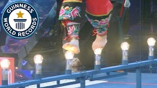 Fastest time to cross 20 m on light bulbs // Guinness World Records Italian Show (Ep 24)