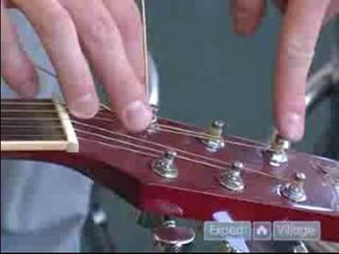 Tips on How to Set Up a Guitar : How to Replace Strings on an Acoustic Guitar