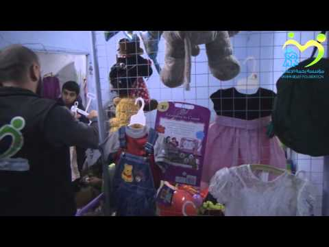 Distribution of clothes, games and food products in the countryside of Latakia