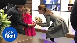 Kate Middleton is presented with flowers by five-year-old