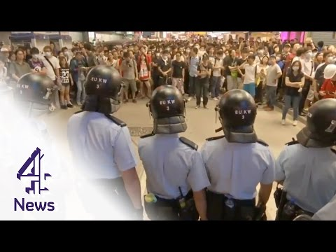 Protesters clash with police in Mongkok area of Hong Kong | Channel 4 News