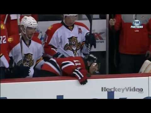 Dmitry Kulikov hits Stephen Gionta into the bench . Apr 20, 2013