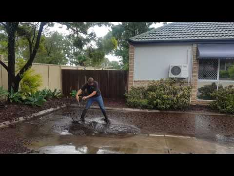 Download Lagu Plumber clearing a blocked grate after storm.mp3