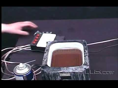 Afinación NISSAN Platina  1.6 L. 16 V. - Lavando inyectores con tina de ultrasonido 8
