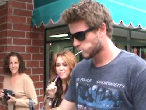 Miley Cyrus and boyfriend Liam Hemsworth with lollipops and paparazzi