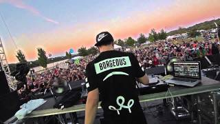 DJ Borgeous performs live in concert for a hyped crowd