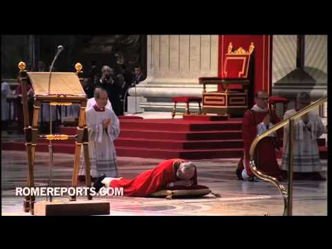 Pope Francis shows adoration for the Cross by lying face down for Good Friday