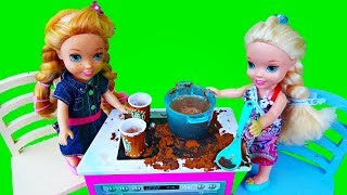 Elsa and Anna toddlers cooking and playing restaurants