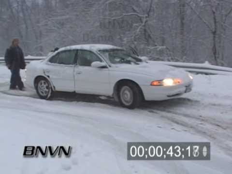 12/31/2006 Heavy snow and traffic backed up and delayed footage.