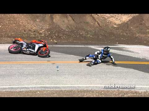 Rider Hits Wet Center Line and Crashes