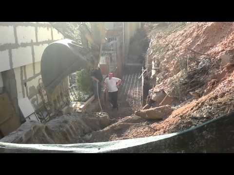 The developer/construction company KOZMA in Skopje forcefully destroys neighbor's property and bullies the owner - single woman against machinery.