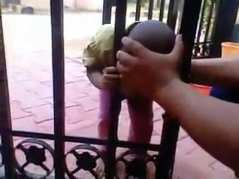 Funny Hyderabadi kid head stuck in gate