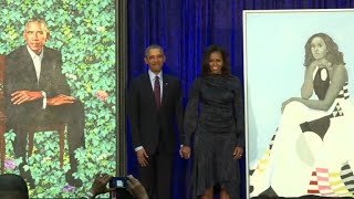 Barack and Michelle Obama's portraits are unveiled