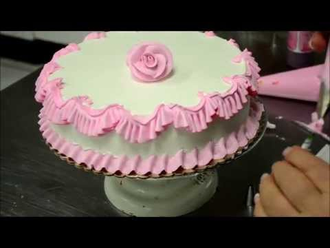 Chef Making a Pink Birthday Cake in Bakery thumbnail