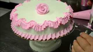 Chef Making a Pink Birthday Cake in Bakery