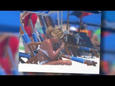 Pregnant Kim Zolciak Smokes a Cigarette in a Bikini - Splash News