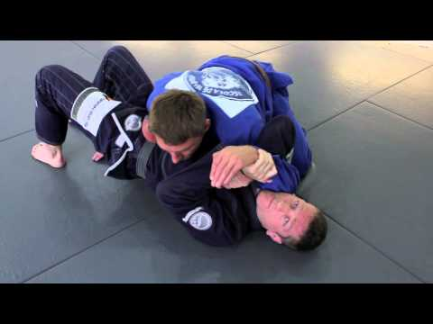 Surprise BJJ attack - submission from underneath side control Image 1
