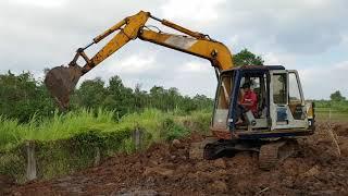 Xe sáng múc cuốc múc đất - xe múc đất ủi đất ruộng