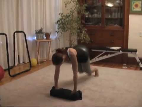 3 Point Plank Jumps with Sandbag Clean & Press exercise Image 1