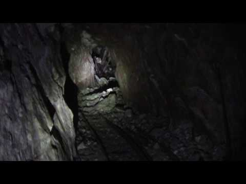 INSIDE OLD GOLD/SILVER MINE WITH TRAMWAY