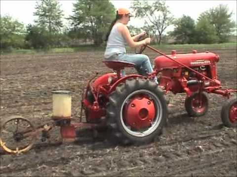 Farmall cub tractor. fast hitch discing and planting