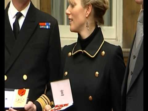 Zara Phillips and Mike Tindall after receiving MBE
