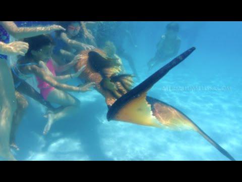 Meet a Mermaid: kids talk to a mermaid at resort pool