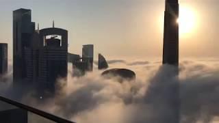 Burj Khalifa morning view above the clouds in dubai
