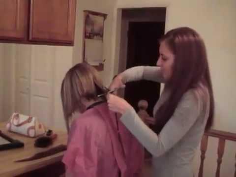 haircut on long brunette hair cut to a bob hair cut