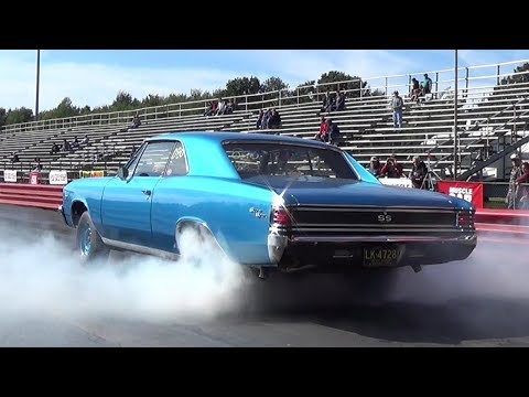 Insane Burnout !! 1970 Camaro SS396 vs 1967 Chevelle SS396 - 1/4 mile Drag Race Video - Road Test TV