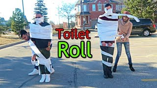 COVERED IN ROLLS of TOILET PAPER