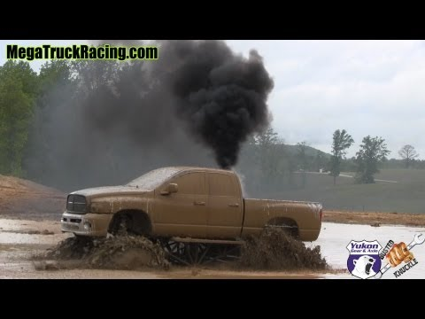 DVDs & SWAG - http://www.4x4swag.com The Oneal Dodge Cummins powered mud truck was rolling coal through a deep nasty mud hole at West Georgia Mud Park. Follo...