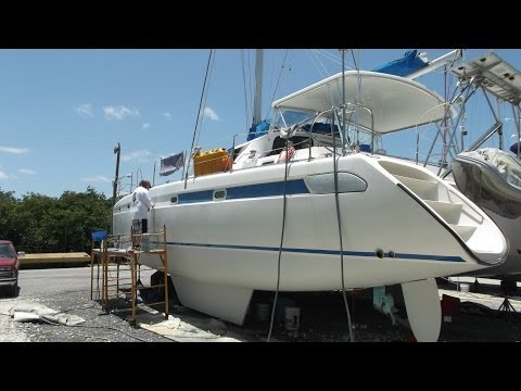 Sailboat Refit - Episode 2 - Self Cleaning Strainer & Removing the Blue Stripe
