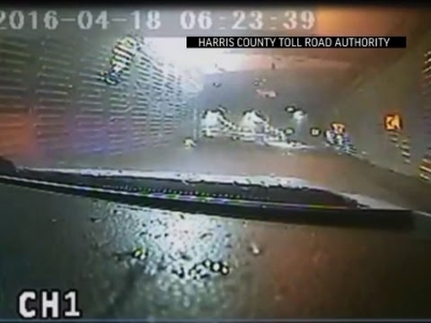 Raw: Toll Worker Tries To Save Woman In TX Flood