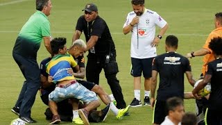 Pitch Invader Takes Down Neymar in Brazil Open Training Session