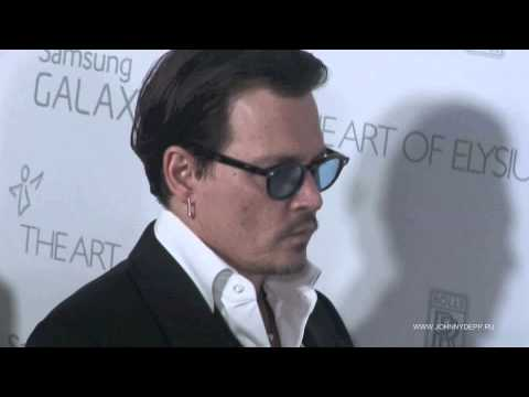 Johnny Depp and his fiancee Amber Heard arrive at The Art of Elysium Heaven Gala, LAA