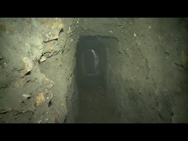 Fighter's tunnel found beneath shop debris in Aleppo