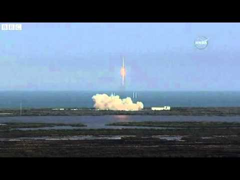 SpaceX lands rocket on ocean barge after take off   BBC News