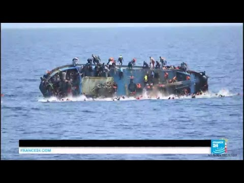 Migrant crisis: Italian navy releases dramatic footage of capsizing boat in Meditteranean
