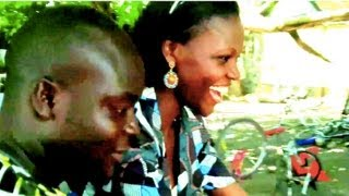 Nigeria Girl rides bicycle for first time after Govt bans motorbikes!