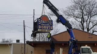Taking down the rt 66 historical Sonrise donut sign