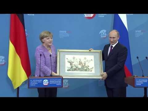 Russian President Vladimir Putin, German Leader Angela Merkel