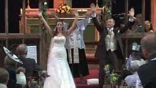 English couple uses flash mob surprise during church wedding