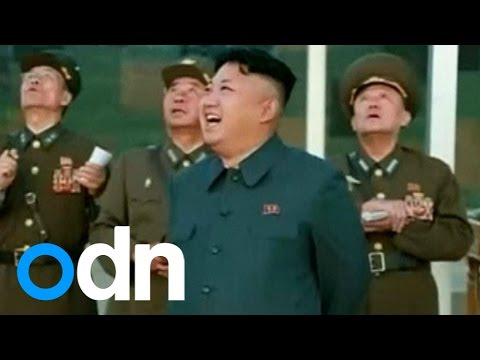 North Korean leader Kim Jong-Un watches paratroop drill
