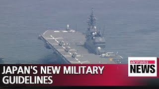 Japan adopts new defense guidelines, agrees to boost military spending over next 5 years