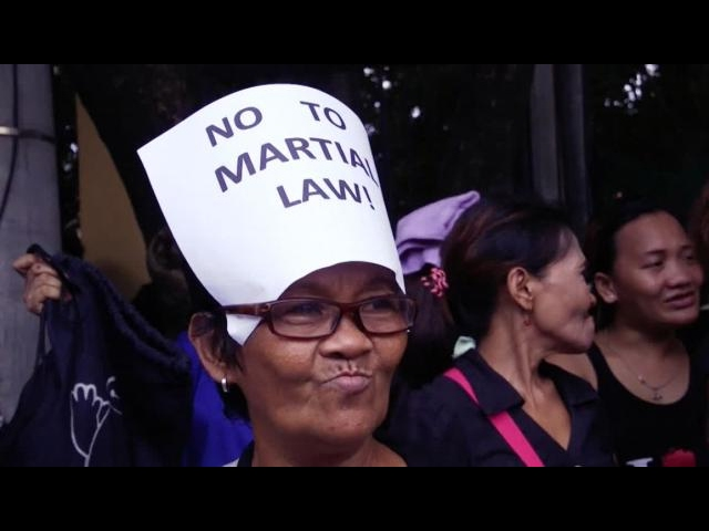 Activist in Manila march against enforcement of martial law in Mindanao