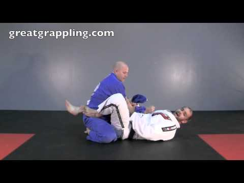 Closed Guard Submission Lapel Feed Armbar Image 1