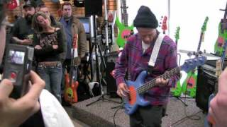 Flea playing a Fleabass at Schmitt Music